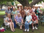 We gather for our group class photo under the shade of our favorite old oak tree at the annual EHS all-class picnic.